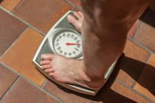 dolor de espalda y exceso de peso